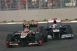 Romain Grosjean, Lotus F1 Team and Pastor Maldonado, Williams F1 Team