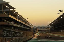 Romain Grosjean, Lotus F1 leads Paul di Resta, Sahara Force India