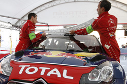 Citroën crew members put on World Champions banner