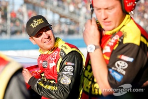 Clint Bowyer, Michael Waltrip Racing Toyota gets out of his wrecked car