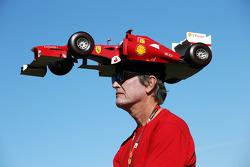 A Ferrari fan with a car on his head