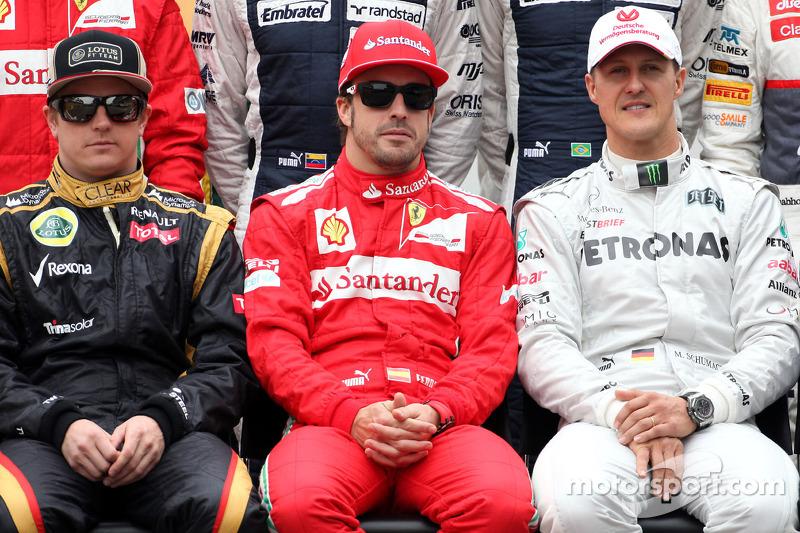 Kimi Raikkonen, Lotus F1 Team, Fernando Alonso, Scuderia Ferrari, y Michael Schumacher, Mercedes GP