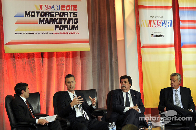 President and CEO of Grand American Road Racing, Ed Bennett, NASCAR President Mike Helton and NHRA President Tom Compton speak onstage at the NASCAR Motorsports Forum