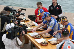 Ford and Holden drivers taking part in a challenge shucking oysters