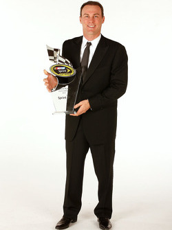 Kevin Harvick with the eighth place trophy