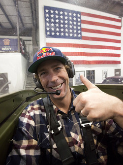 Travis Pastrana waits in the cockpit of a P-51 Mustang for a ride with team owner Jack Roush