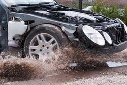 Mercedes E Class hitting pothole