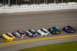 Kyle Busch, Joe Gibbs Racing Toyota leads a group of cars