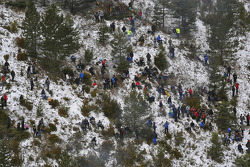 Spectators on a snowy hill