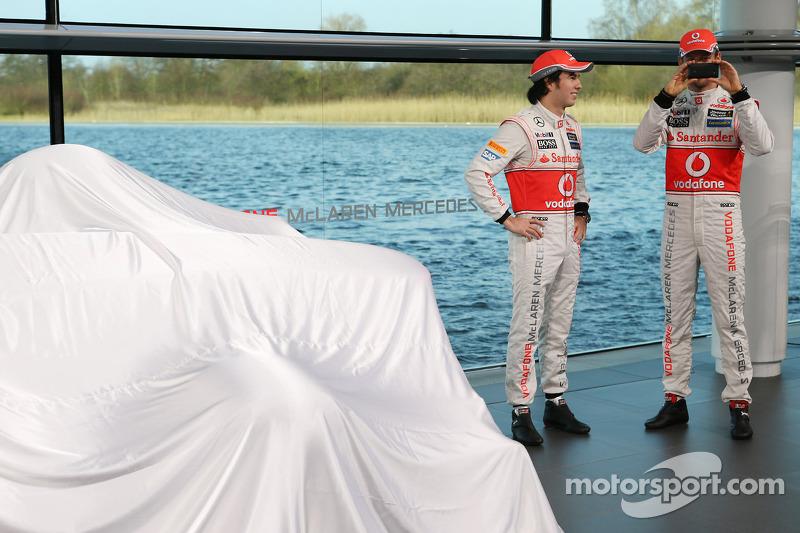Sergio Perez, McLaren with team mate Jenson Button, McLaren