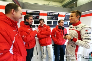 Luiz Razia, Marussia F1 Team and team mate Max Chilton, Marussia F1 Team with engineers