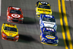 Joey Logano, Penske Racing Ford and Martin Truex Jr., Michael Waltrip Racing Toyota battle for position