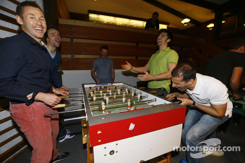 Tom Kristensen, Jamie Green, Marco Bonanomi and Marc Gene play foosball