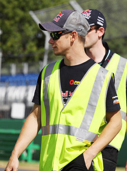 Casey Stoner, former MotoGP Rider and V8 Supercar Driver and the Triple Eight team walk the circuit wearing high vis jackets