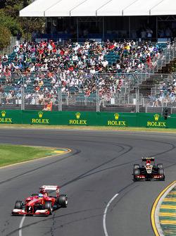 Fernando Alonso, Ferrari F138 and Romain Grosjean, Lotus F1 E21