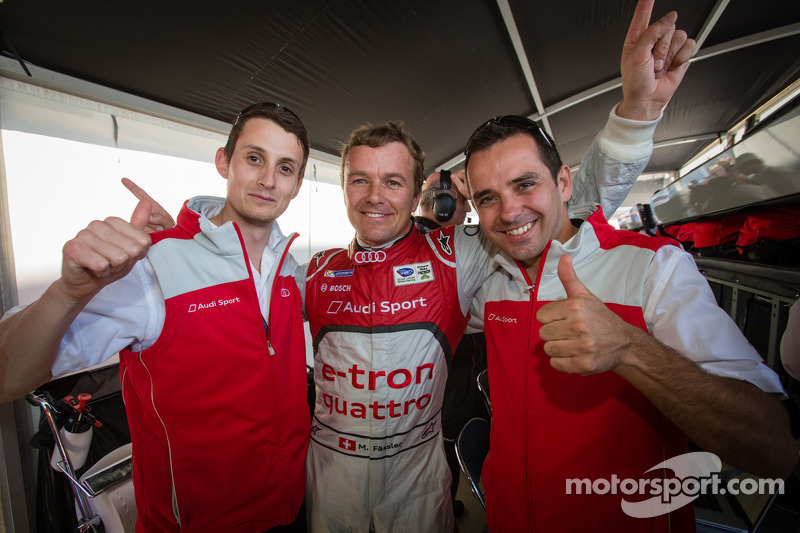 P1 and overall pole winner Marcel Fässler celebrates with Oliver Jarvis and Benoit Tréluyer