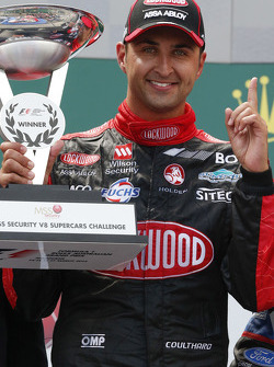 Podium: race winner Fabian Coulthard