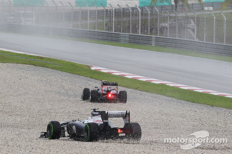 Mark Webber, Red Bull Racing RB9 and Valtteri Bottas, Williams FW35 go off in the wet on the sighting lap