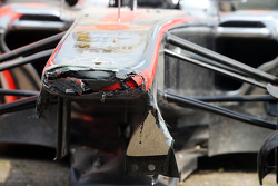 The McLaren MP4-28 of Sergio Perez, McLaren after he crashed at the pit entrance at the end of the first practice session