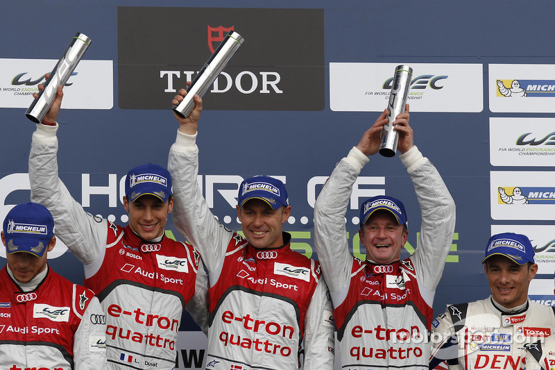 Podium: overall winners Tom Kristensen, Allan McNish, Loic Duval