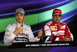 (L to R): Pole sitter Nico Rosberg, Mercedes AMG F1 and Fernando Alonso, Ferrari in the FIA Press Conference