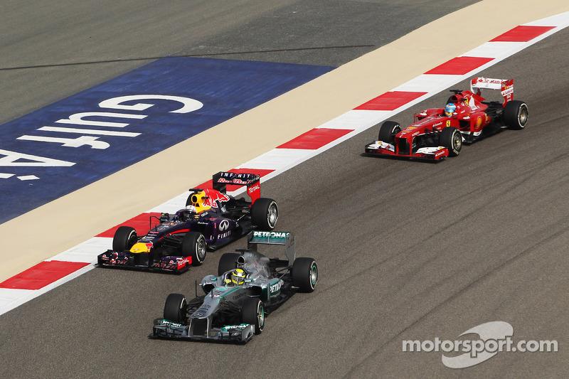 Nico Rosberg, Mercedes AMG F1 W04 leads Sebastian Vettel, Red Bull Racing RB9