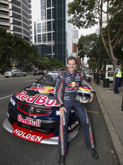Craig Lowndes drives through the city streets of Perth