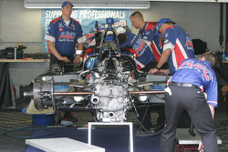 A.J. Foyt Enterprises crew members rebuild Conor Daly's car