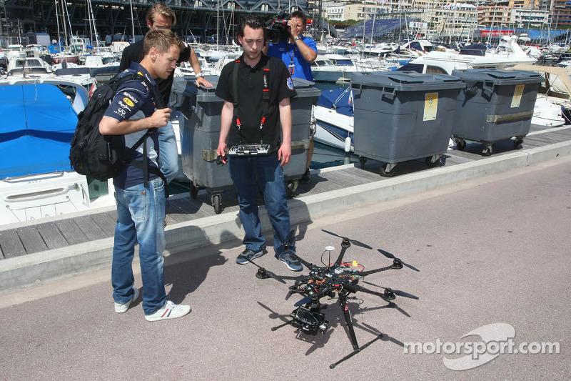 Sebastian Vettel, Red Bull Racing looks at a motorised helicopter