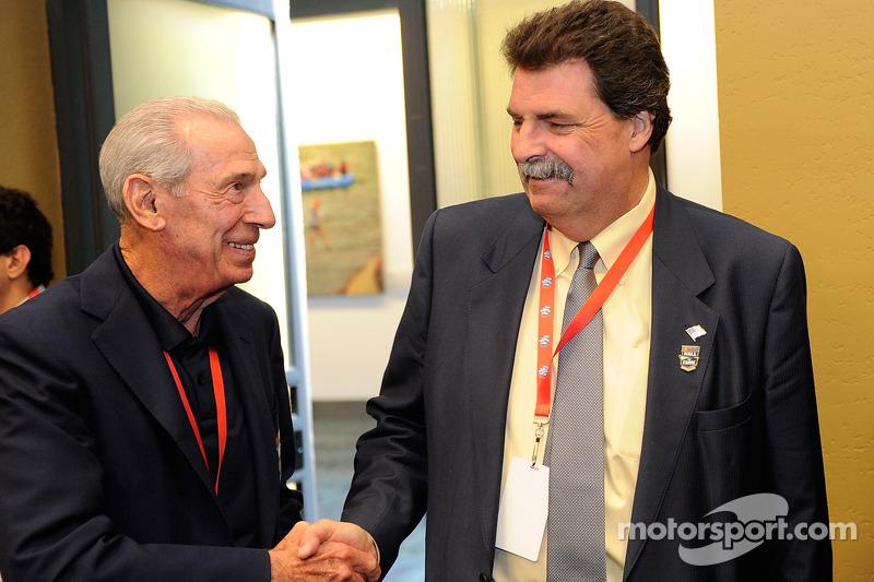 NASCAR Hall of Famer Ned Jarrett talks with NASCAR President Mike Helton