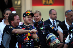 Sebastian Vettel, Red Bull Racing celebrates his second position with Christian Horner, Red Bull Racing Team Principal on the podium