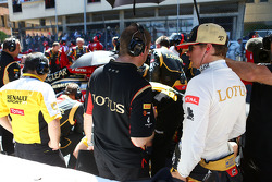 Kimi Raikkonen, Lotus F1 Team on the grid as the race is stopped