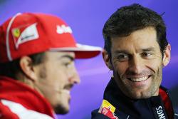 Mark Webber, Red Bull Racing and Fernando Alonso, Ferrari in the FIA Press Conference.