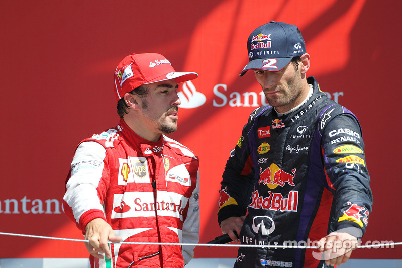 Fernando Alonso Ferrari with Mark Webber Red Bull Racing on the podium