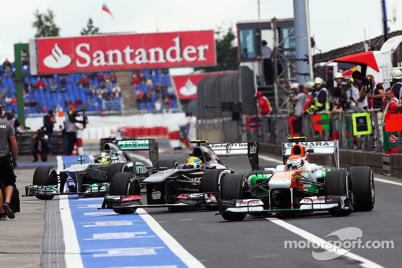Adrian Sutil, Sahara Force India VJM06, Esteban Gutierrez, Sauber C32 en Nico Rosberg, Mercedes AMG