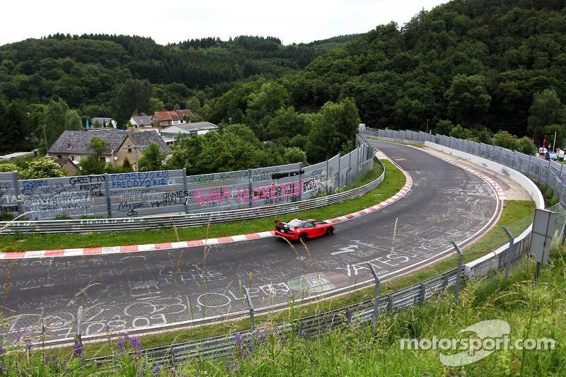 Cars run on the Nordschleife