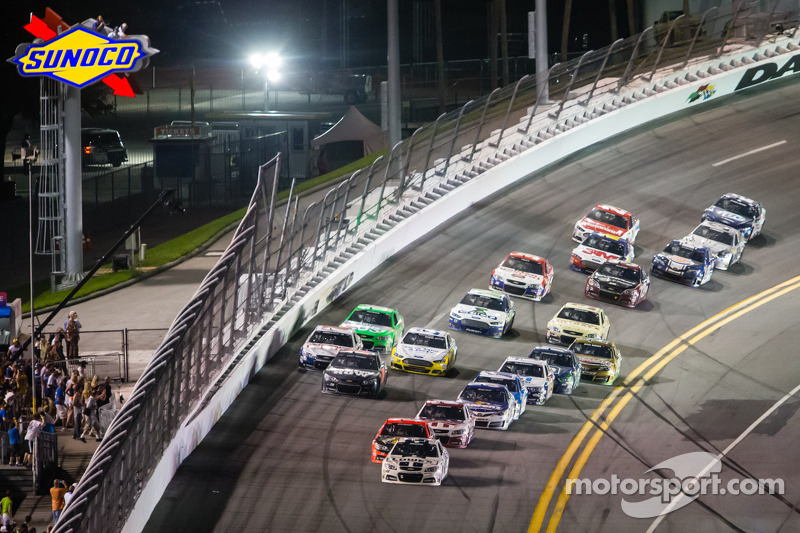 Jimmie Johnson, Hendrick Motorsports Chevrolet leads the field out of turn 4