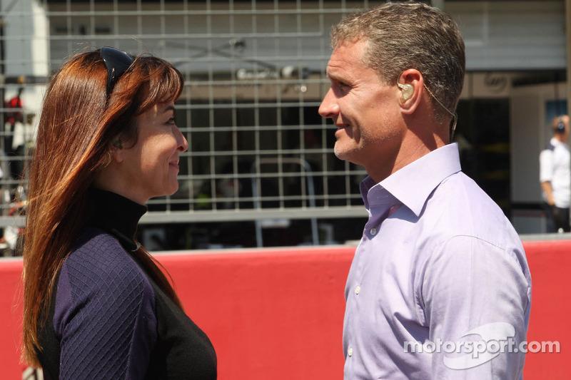 (L to R): Suzi Perry, BBC F1 Presenter with David Coulthard, Red Bull Racing and Scuderia Toro Advisor / BBC Television Commentator