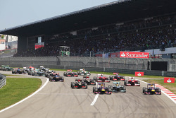 Sebastian Vettel, Red Bull Racing RB9, Lewis Hamilton, Mercedes AMG F1 W04 and Mark Webber, Red Bull Racing RB9 lead at the start of the race