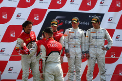 The podium: winners Maximilian Buhk, Alon Day, second place Stéphane Ortelli, Laurens Vanthoor, thir