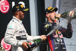 Lewis Hamilton, Mercedes AMG F1 and Sebastian Vettel, Red Bull Racing RB9