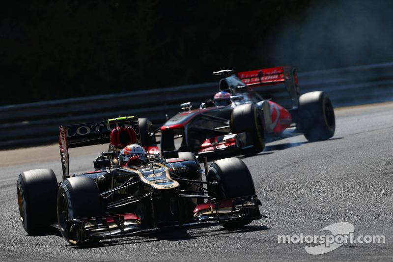 Romain Grosjean, Lotus F1 E21 leads Jenson Button, McLaren MP4-28