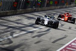 Felipe Massa, Williams FW40, Kimi Raikkonen, Ferrari SF70H, in the pit lane