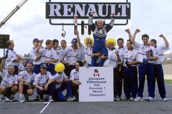 World Champion Jacques Villeneuve celebrates with his Williams team