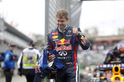 Sebastian Vettel, Red Bull Racing celebrates after taking Pole Position