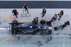 Kevin Magnussen, Haas F1 Team VF-17, is attended to by pit crew