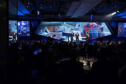 Robert Kubica on stage with Presenters David Coulthard, Lee McKenzie