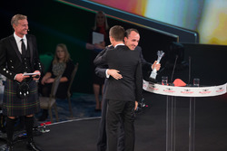 Robert Kubica presents the Rally Driver of the Year award to Sébastien Ogier