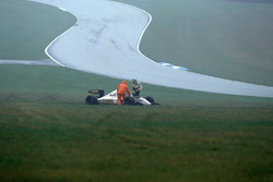 Seventh placed Fabrizio Barbazza, climbs from his Minardi M193 Ford after spinning off at the Craner Curves