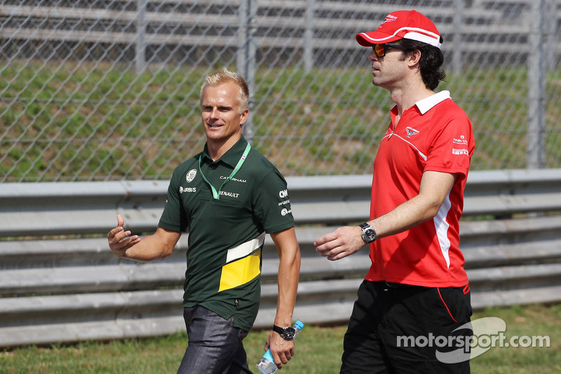 (L to R): Heikki Kovalainen walks the circuit with Marc Hynes, Marussia F1 Team Driver Coach